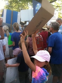 My daughter carrying her sign.